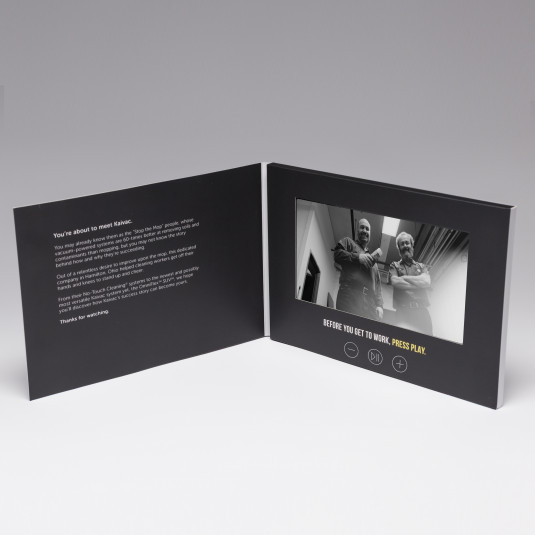 """Red Paper Plane's 7"""" HD Video Brochure - Quick Turn contains a play/pause button, as well as volume controls."""